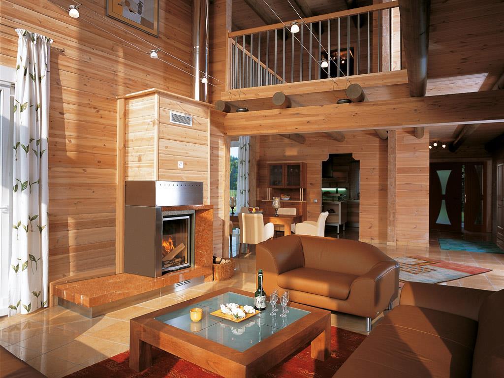 Salon avec murs en bois type chalet et cheminée Maisons Elk