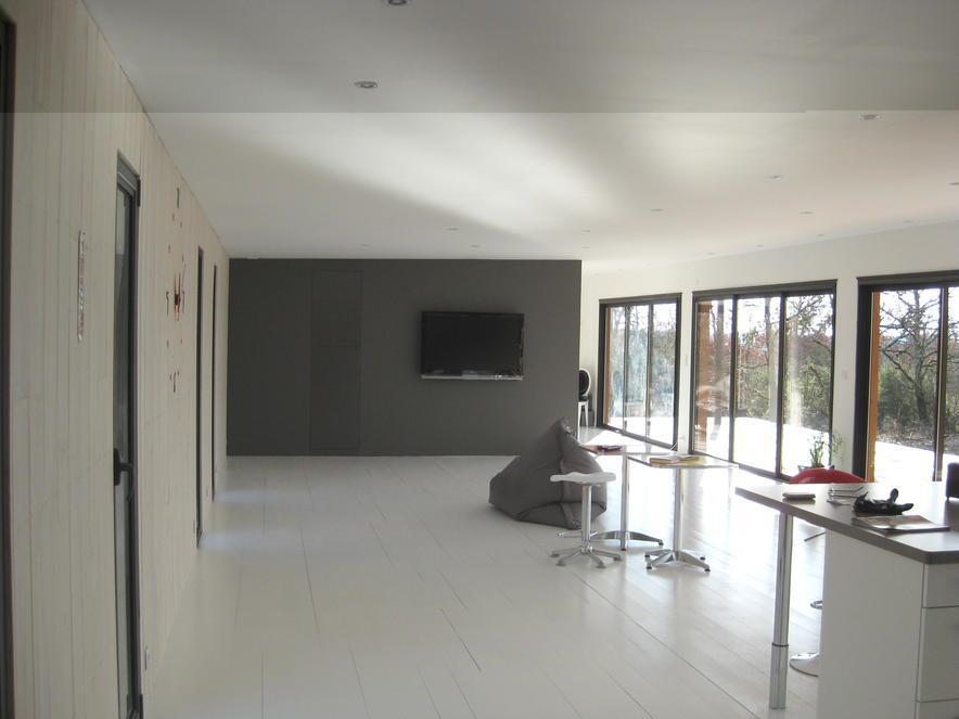 salon contemporain d 39 une villa en ossature bois batitec photo n 45 domozoom. Black Bedroom Furniture Sets. Home Design Ideas