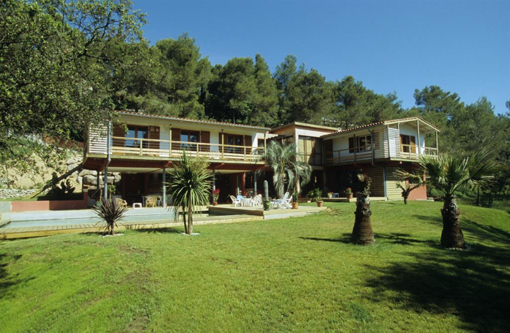 Image Villa bois sur pilotis avec piscine Brice Le Bouvier