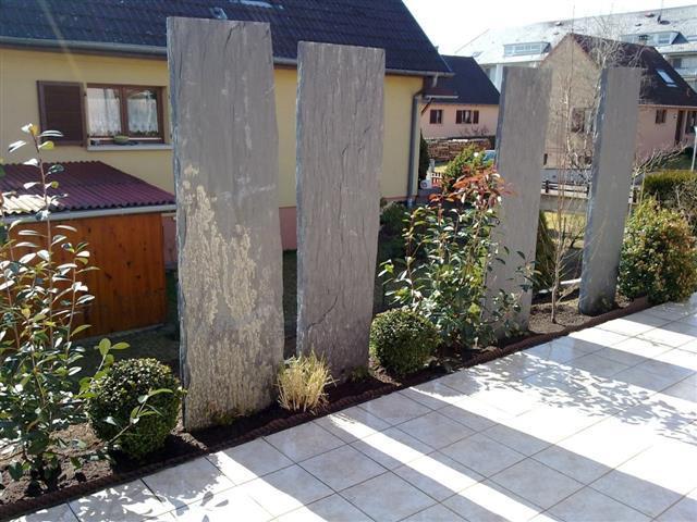 Terrasse avec cl ture min rale et v g tale kubler et wolfarth paysagistes for Jardin exterieur design