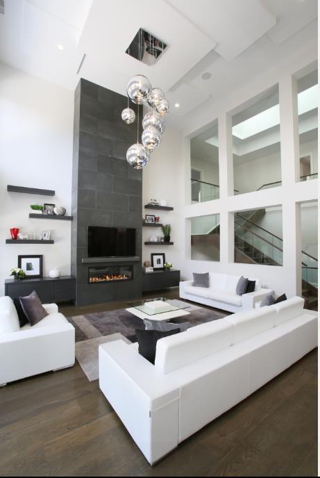 Salon lumineux avec une grande hauteur sous plafond - Woonkamer deco design ...