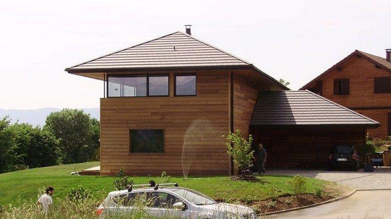 Maison en bois moderne for Porche de maison en bois