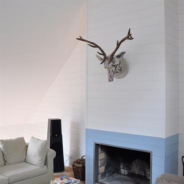 Une cheminée sur une mezzanine