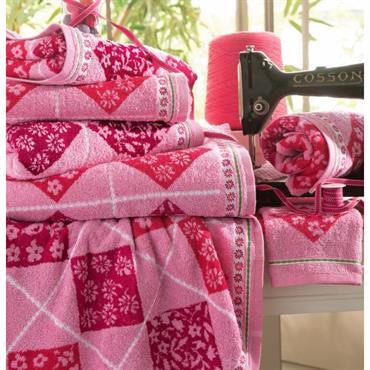 Une atmosphère colorée pour une collection fraîche et créative Eponge 100% coton, 400 g/m² Lavable à 60° Tissage jacquard effet patchwork et liteau jacquard