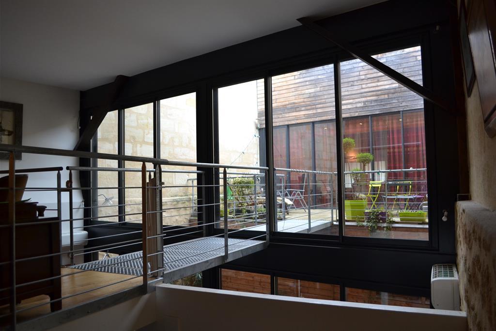 Image Passerelle depuis séjour au dessus cuisine Cabinet d'architecture Agnès Barokel