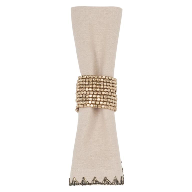 Serviette en coton beige et rond de serviette en perles