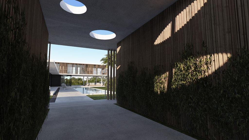 Image Passage couvert en bois et béton avant l'accès à la villa Jean-Yves Arrivetz