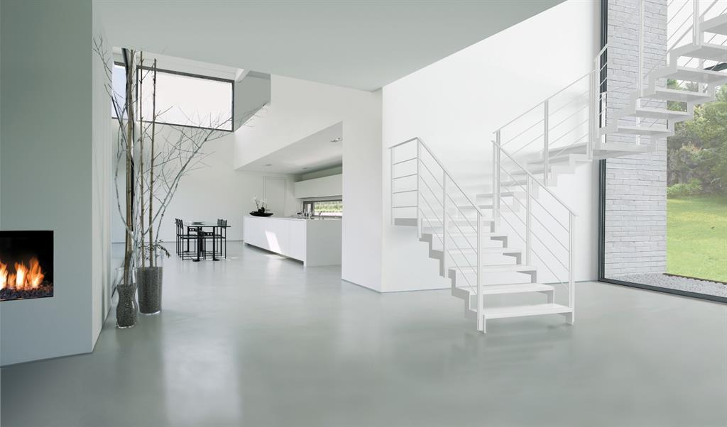 Image Pièce à vivre avec escalier en métal blanc lionel huet