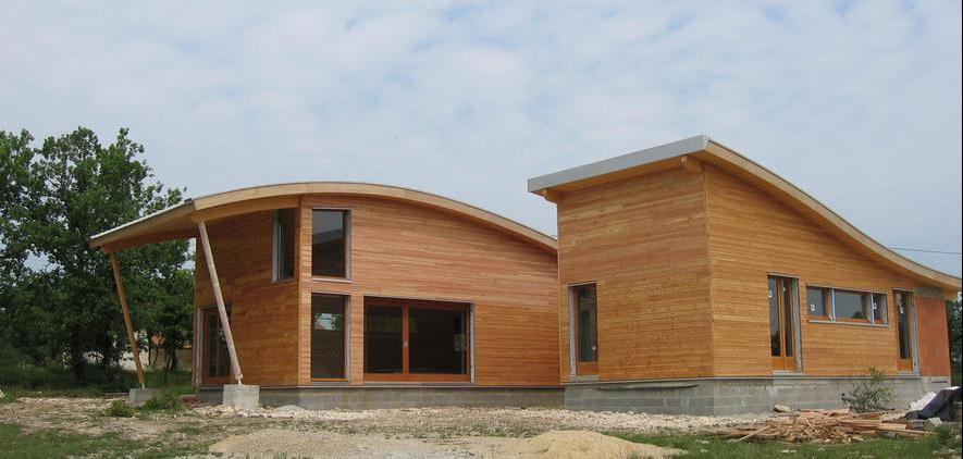 Villa contemporaine avec courbes en ossature bois