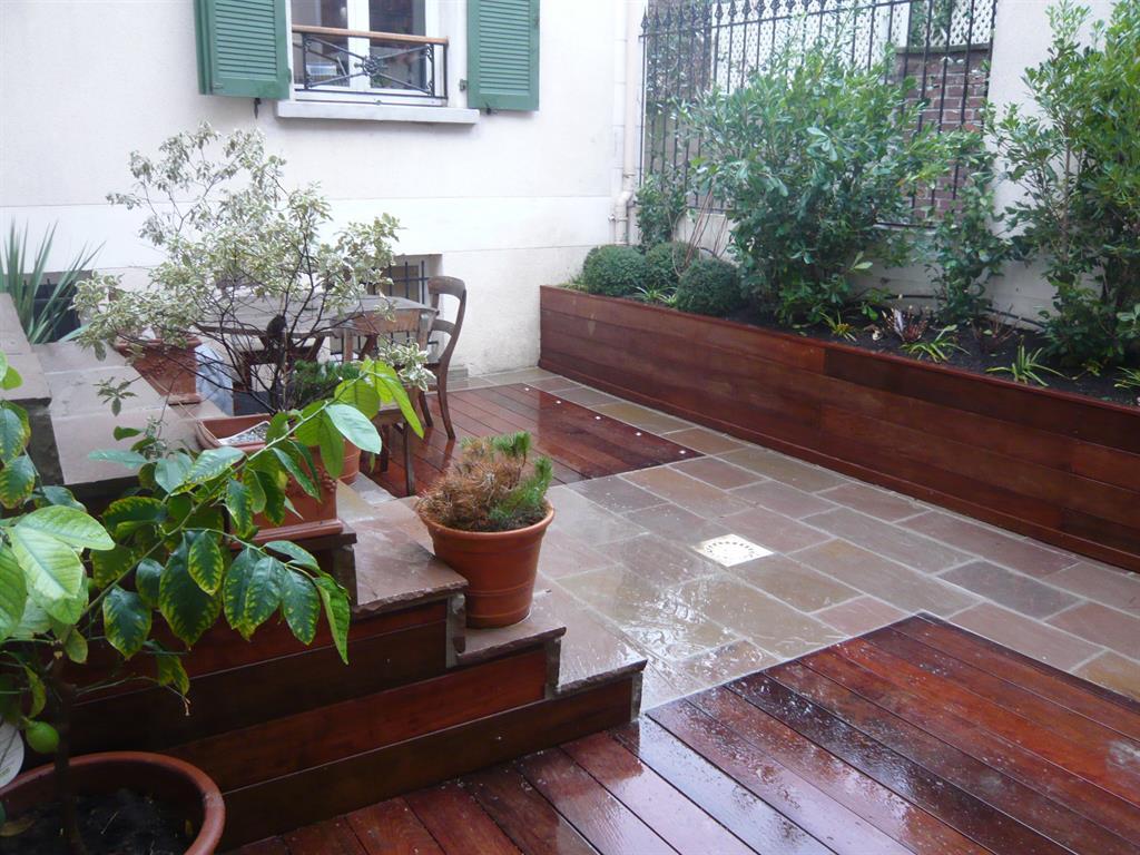 La terrasse est réaménagée avec deux matériaux Scènes D\'extérieur