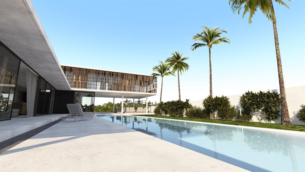 Terrasse ombragée en béton face à la piscine Jean-Yves Arrivetz