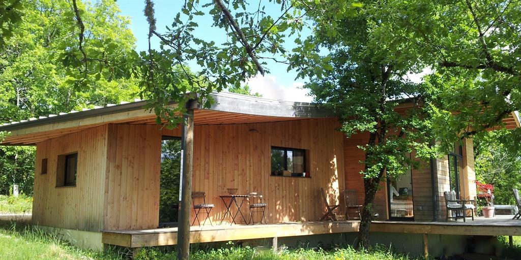 Maison bois - charpente courbe - isolation fibre de bois