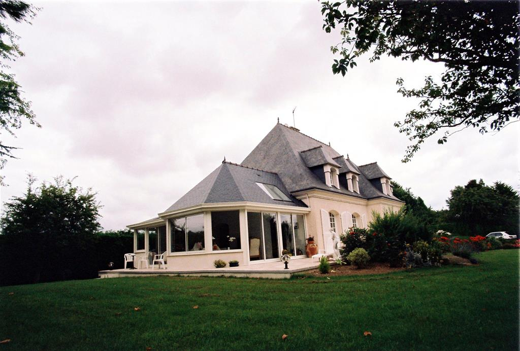 Image Vue extérieure d'une extension avec un toit en ardoise Vérandaline