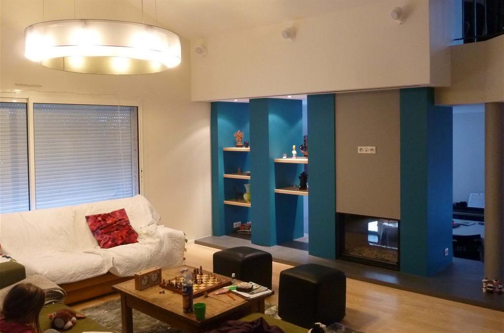 Image espace de séjour avec cheminée double face vincent guillo architecte d intérieur