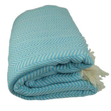 Plaid au décor éthnique en chevron turquoise. Plaid 100% coton et artisanal. Autres couleurs disponibles.  Domozoom