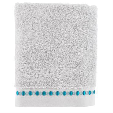 La drap de douche Riviera de couleur perle est composé de bouclette de coton 600 g/m² brodée façon bijou le long du liteau.