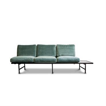 Canapé en velours vert et marbre marbre noir