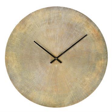 Horloge en métal strié coloris laiton D74