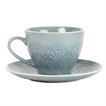 Tasse et soucoupe en faïence bleue à motifs