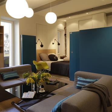 Studio type Loft avec cloisons chambre ouvertes