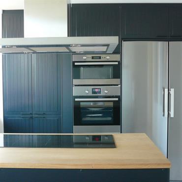 L'ilot central permet de délimiter la cuisine et le coin repas