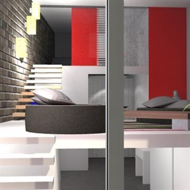 Salon TV et cuisine en sous-sol. Mur en briques apparentes, couleurs blanche et rouge