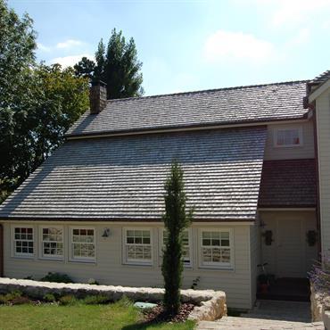 Maison ossature  bois , bardage à clins,couverture tuile de bois