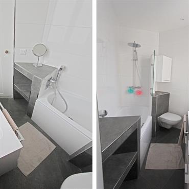 Incorporation d'une baignoire en acier emeuillé en pan coupé pour favoriser la circulation, et équipée d'une robinetterie murale avec douchette à led-côté bain.  A côté de la douche se dresse également ...