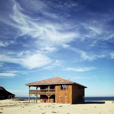 Maison bois avec terrasse sur pilotis