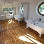 La salle de bain se reflète dans les portes miroitantes du dressing