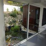 Le bassin de récupération des eaux pluviales dans le patio