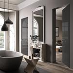 Salle de bain mélangeant moderne et classique avec baignoire îlot